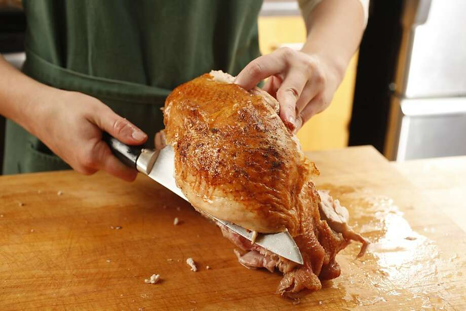Slicing a breast off of a Bestway air dried turkey. Photo: Craig Lee, Special To The Chronicle