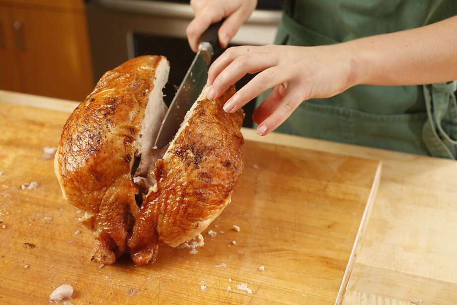 Removing a breast of a Bestway air dried turkey. Photo: Craig Lee, Special To The Chronicle