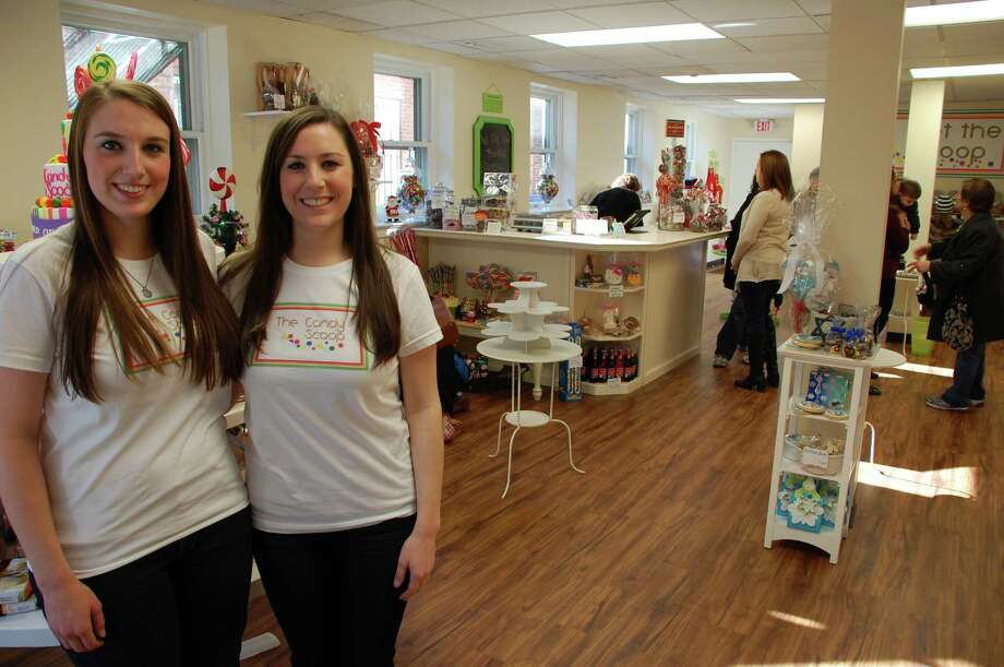 Megan Palladino, left, and her sister, Lauren, are making their dream come true with The Candy Scoop, which recently opened in downtown New Canaan. Jarret Liotta/For the New Canaan News Photo: Contributed Photo, Contributed / New Canaan News Contributed