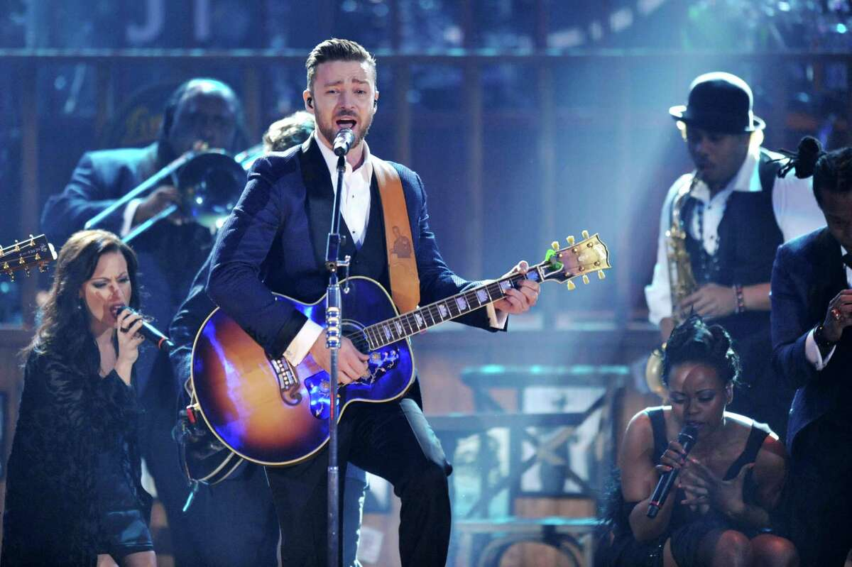 Justin Timberlake, center, performs on stage at the American Music Awards at the Nokia Theatre L.A. Live on Sunday, Nov. 24, 2013, in Los Angeles. (Photo by John Shearer/Invision/AP) ORG XMIT: CACJ296