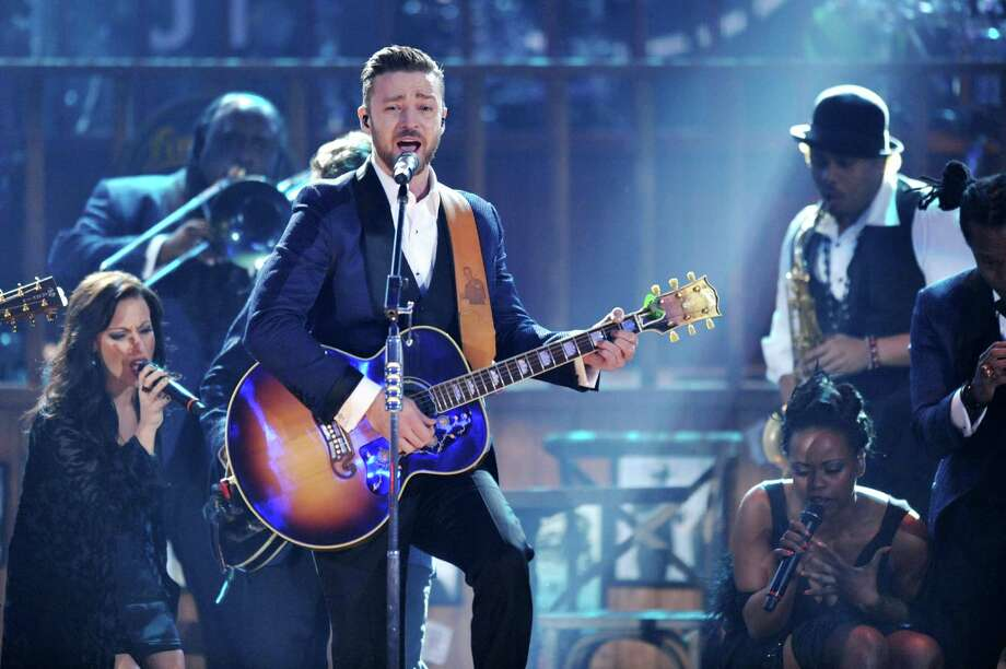 Justin Timberlake, center, performs on stage at the American Music Awards at the Nokia Theatre L.A. Live on Sunday, Nov. 24, 2013, in Los Angeles. (Photo by John Shearer/Invision/AP) ORG XMIT: CACJ296 Photo: John Shearer, AP / Invision
