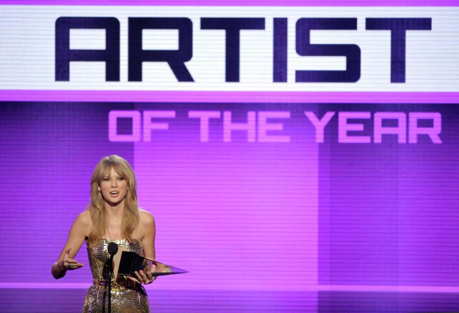 Taylor Swift accepts the award for artist of the year at the American Music Awards at the Nokia Theatre L.A. Live on Sunday, Nov. 24, 2013, in Los Angeles. (Photo by John Shearer/Invision/AP) ORG XMIT: CACJ466 Photo: John Shearer, AP / Invision