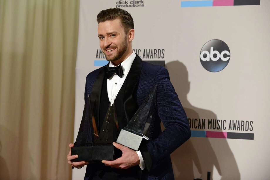 "Justin Timberlake poses backstage with his awards for favorite male artist - pop/rock, favorite male artist - soul/R&B, and favorite album - soul/R&B for ""The 20/20 Experience"" at the American Music Awards at the Nokia Theatre L.A. Live on Sunday, Nov. 24, 2013, in Los Angeles. (Photo by Jordan Strauss/Invision/AP) ORG XMIT: CACJ335 Photo: Jordan Strauss, AP / Invision"