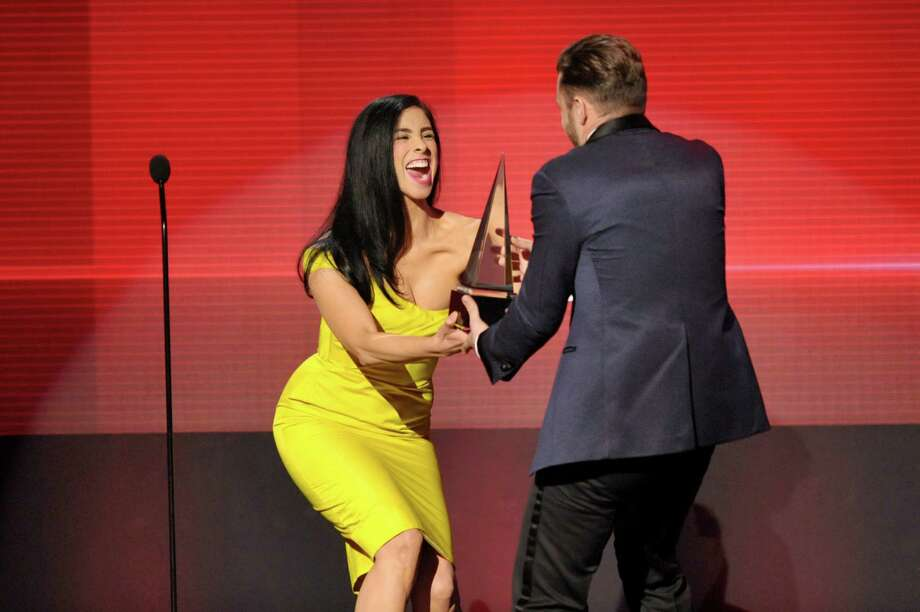 "Sarah Silverman presents the award for favorite album - soul/R&B to Justin Timberlake for ""The 20/20 Experience"" at the American Music Awards at the Nokia Theatre L.A. Live on Sunday, Nov. 24, 2013, in Los Angeles. (Photo by John Shearer/Invision/AP) ORG XMIT: CACJ319 Photo: John Shearer, AP / Invision"