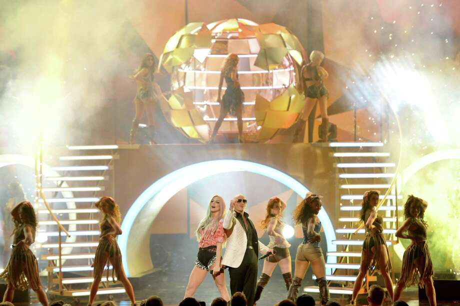 Ke$ha, center left, and Pitbull, center right, perform on stage at the American Music Awards at the Nokia Theatre L.A. Live on Sunday, Nov. 24, 2013, in Los Angeles. (Photo by John Shearer/Invision/AP) ORG XMIT: CACJ273 Photo: John Shearer, AP / Invision
