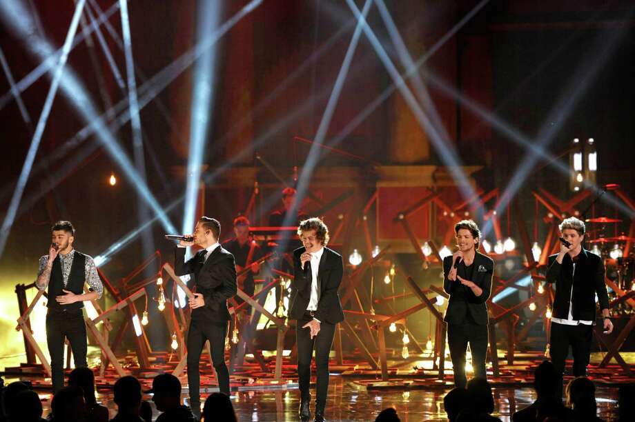 From left, Zayn Malik, Liam Payne, Harry Styles, Louis Tomlinson, and Niall Horan of the musical group One Direction perform on stage at the American Music Awards at the Nokia Theatre L.A. Live on Sunday, Nov. 24, 2013, in Los Angeles. (Photo by John Shearer/Invision/AP) ORG XMIT: CACJ259 Photo: John Shearer, AP / Invision