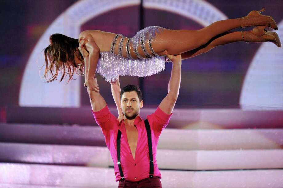 Maksim Chmerkovskiy, seen standing, performs with Jennifer Lopez at the American Music Awards at the Nokia Theatre L.A. Live on Sunday, Nov. 24, 2013, in Los Angeles. (Photo by John Shearer/Invision/AP) ORG XMIT: CACJ326 Photo: John Shearer, AP / Invision