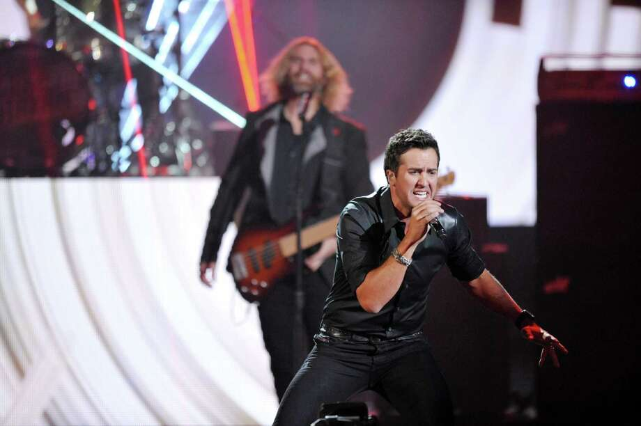 Luke Bryan performs on stage at the American Music Awards at the Nokia Theatre L.A. Live on Sunday, Nov. 24, 2013, in Los Angeles. (Photo by John Shearer/Invision/AP) ORG XMIT: CACJ355 Photo: John Shearer, AP / Invision