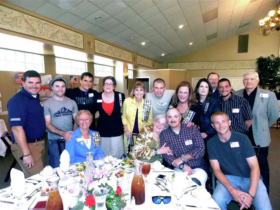 "During the recent Heritage Trails DAR chapter luncheon and fundraiser honoring U.S. veterans, members of the chapter took pictures with special guests and wounded warriors representing the ""Helping a Hero"" organization, veterans and staff of Camp Hope. Photo: Courtesy"