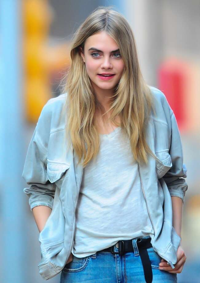 Model Cara Delevingne, at 21, has more than 3 million Instagram followers and is known for her bold eyebrows. (Photo by Raymond Hall/FilmMagic) Photo: Raymond Hall, FilmMagic