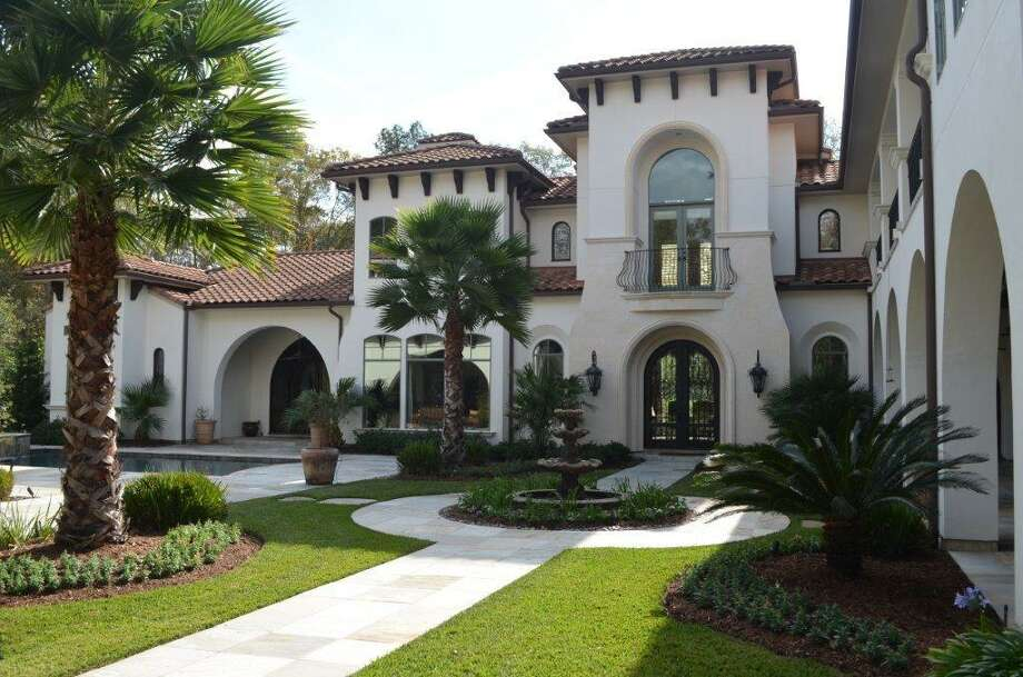 34 Hepplewhite Way: This 2008 mega compound has 5-6 bedrooms, 5 full and 3 half bathrooms, 9,346 square feet, and features a two-story paneled study, balconies overlooking the Nicklaus golf course, and an open courtyard for outdoor entertaining. Listed for $3,800,000. Contact agent Beth Ferester at 713-702-6334 for more information. Photo: HAR.com