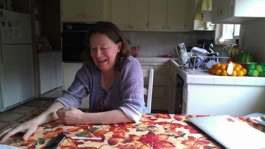 San Mateo County Poet Laureate Caroline Goodwin at her kitchen table in Montara. The Chronicle/Sam Whiting