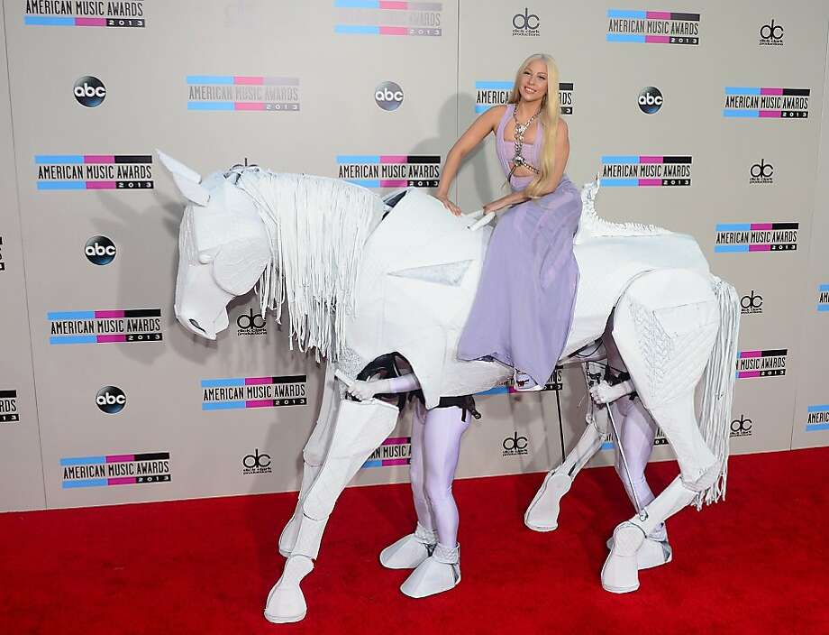 Lady Gaga went to L.A., riding on a pony:Hope he doesn't leave a road   apple on the American Music Awards red carpet. Photo: Frederic J. Brown, AFP/Getty Images