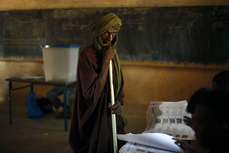 Balloting begins in Mali: A Tamacheq herdsman waits for election officials in Gao to check his voting card before casting his ballot in Mali's parliamentary elections. Photo: Jerome Delay, Associated Press