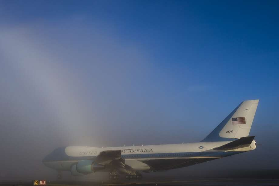 Air Force One is shown with sunlight hitting fog and creating a subtle rainbow following a day of Seattle fundraisers by President Barack Obama. Photo: JORDAN STEAD, SEATTLEPI.COM