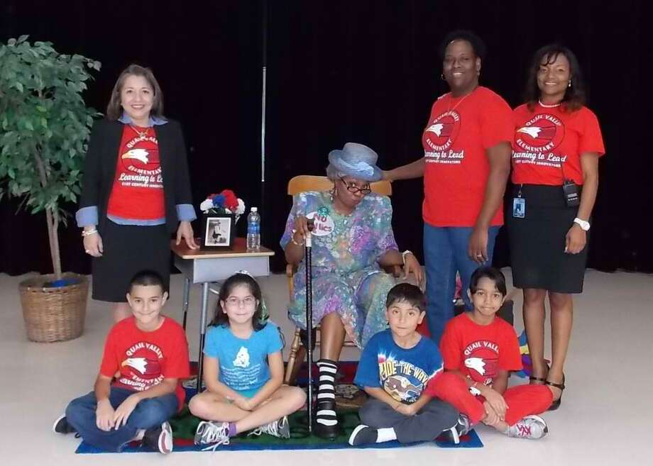 Front row, from left, Gabriel Vasquez, Sara Dean, Vincente Dean and Jackie Athaide; and, back row, Lulu DeAnda, Lisa Jones and Shenique Spears visited with Seeju Dupre, who played Granny Dupre at Quail Elementary School's anti-bullying presentation. Photo: Courtesy Of Fort Bend Independent School District