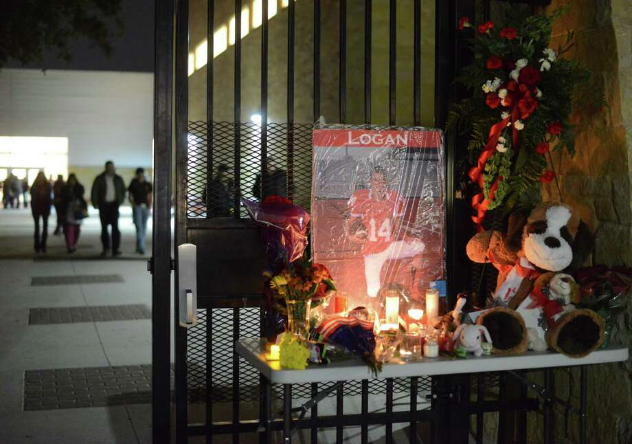 An altar honors the memory of Logan Davidson, a student who died after being beaten at school in New Braunfels.  A reader comments on the tragedy. Photo: Billy Calzada / San Antonio Express-News