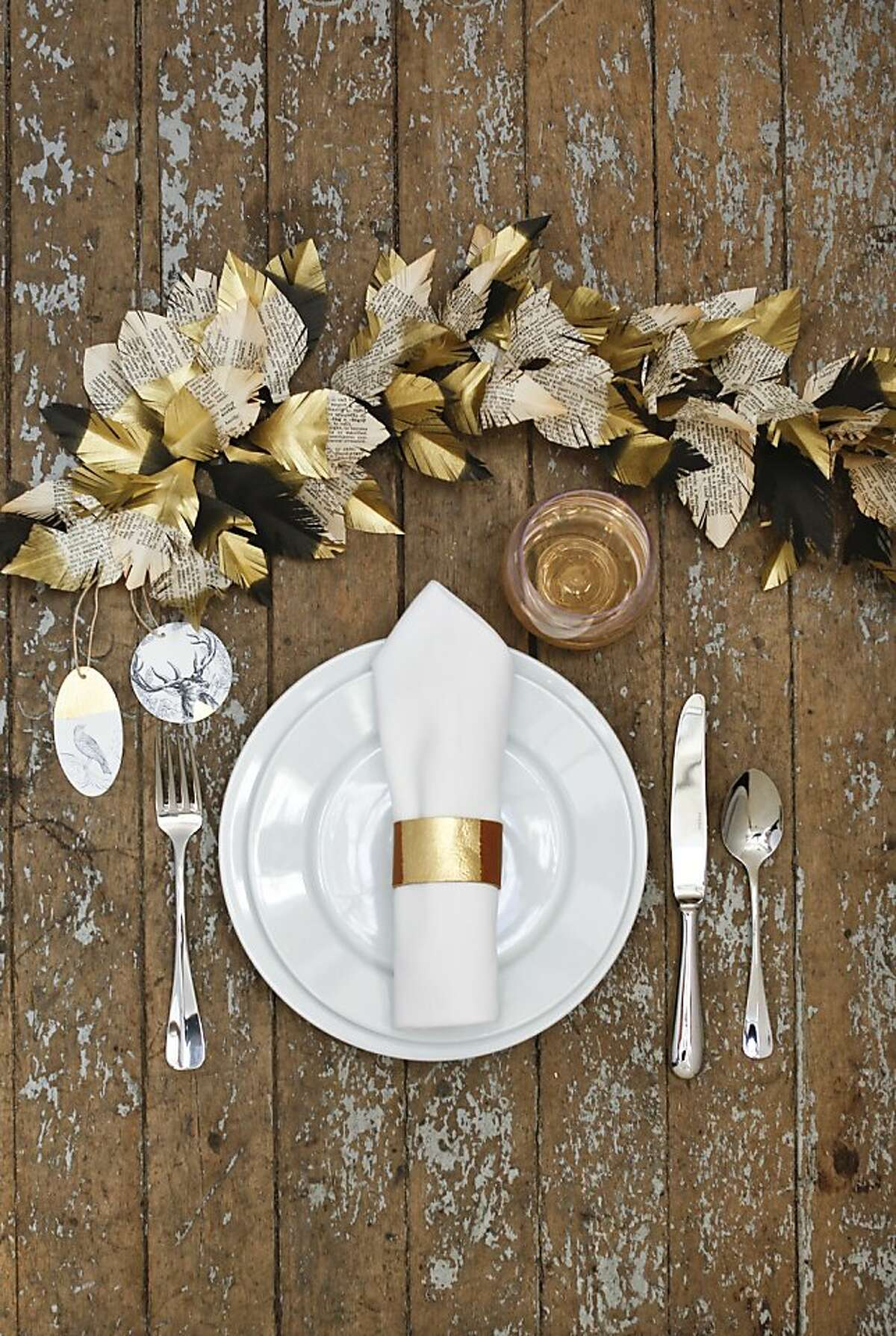San Francisco Creativebug offers online videos on a variety of crafts. Instructor Courtney Cerruti shares three projects to add give your holiday home a DIY touch. To start, click through the photos for step-by-step instructions to create this elegant leaf and feather garland and leather napkin ring.