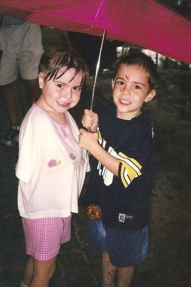 Shannon Faught and Zachary Greenberg try to stay dry during the 2000 Texas Renaissance Festival in Plantersville. They were both about 5 years old at the time, according to Shannon s mom Eileen. She and Zach s mom Brigid have been friends since high school. Photo: Handout, Faught, Reader Submission