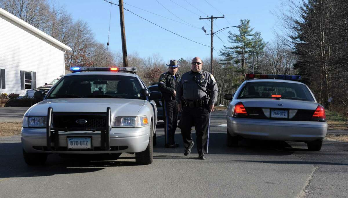 On Monday, Nov. 25, 2013, police block the entrance to the site of the old Sandy Hook Elementary School, in Newtown, Conn. where 20 children and six educators were killed last December.