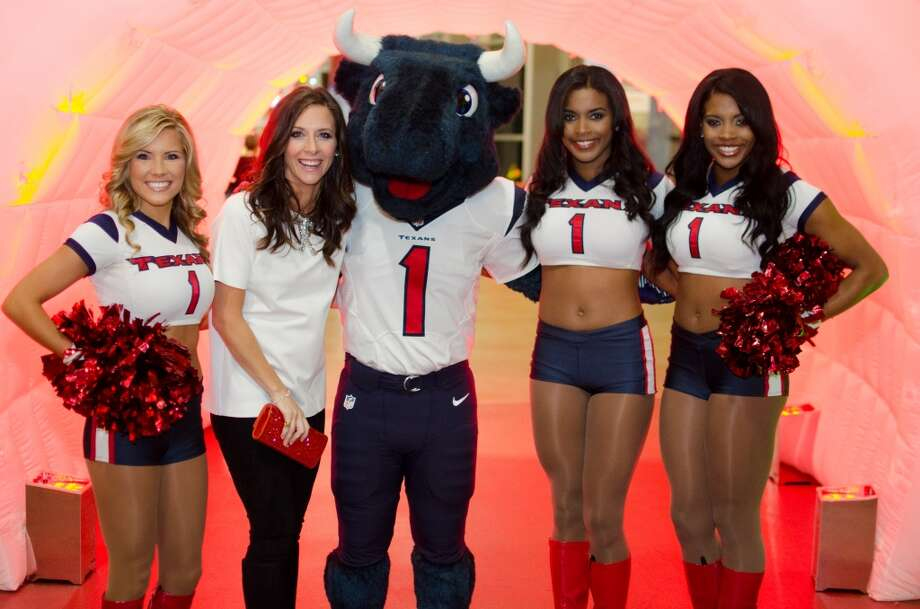 Hannah McNair poses with Toro and Houston Texans Cheerleaders during Friday Night Lights Benefiting Depelchin Children's Center on Friday, Nov. 15. Photo: Jamaal Ellis, For The Chronicle