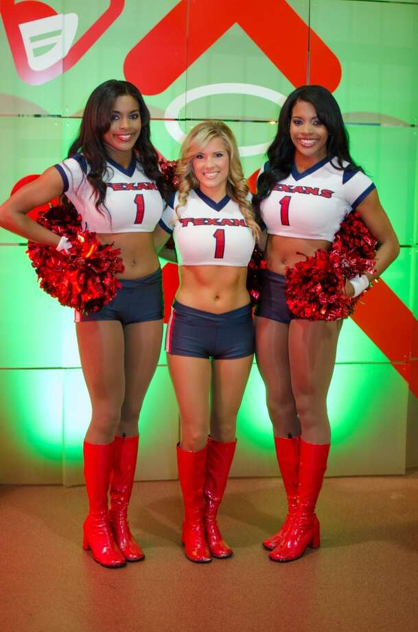 Houston Texans Cheerleaders Schuyler, Kayla, and Dresdynn greet attendees at the entrance Friday Night Lights Benefiting Depelchin Children's Center  on Friday, Nov. 15. Photo: Jamaal Ellis, For The Chronicle