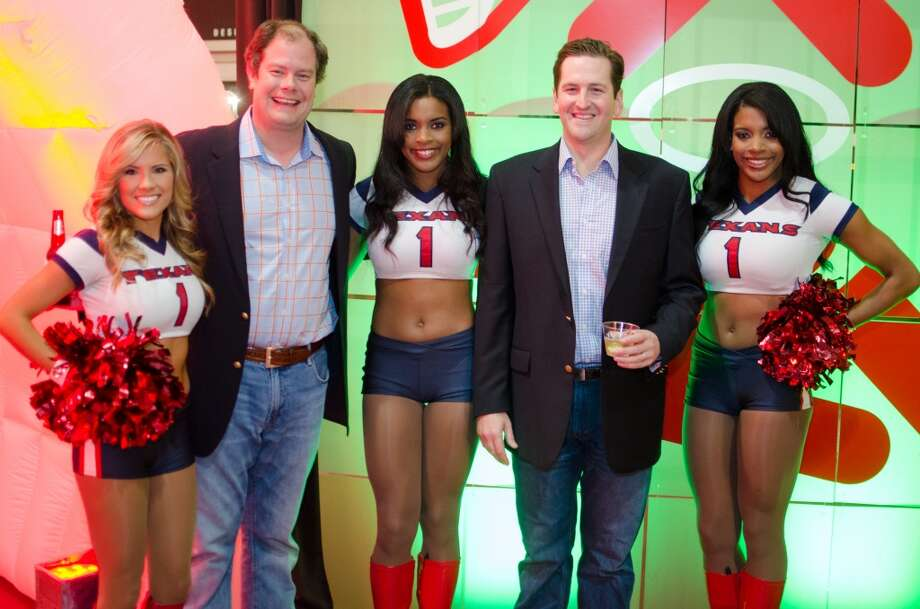 Boorks Young and David Valentiine with Houston Texans Cheerleaders Kayla, Dresdynn, and Schuyler during Friday Night Lights Benefiting Depelchin Children's Center  on Friday, Nov. 15. Photo: Jamaal Ellis, For The Chronicle