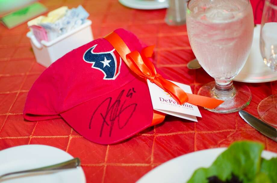 Autographed hats are among the take-home favors at Friday Night Lights Benefiting Depelchin Children's Center on Friday, Nov. 15. Photo: Jamaal Ellis, For The Chronicle
