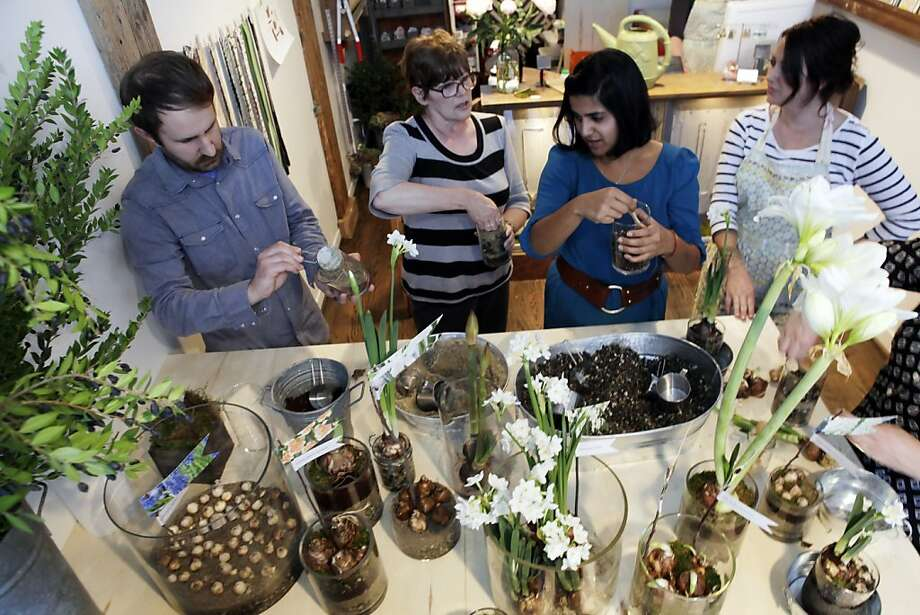 Alethea Harampolis (right) observes students during a floral arranging class at Studio Choo, her flower shop with business partner Jill Rizzo, in San Francisco. Photo: Carlos Avila Gonzalez, The Chronicle