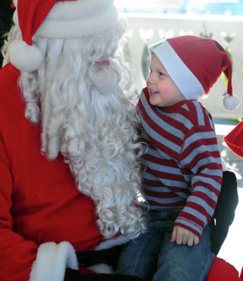 Jack Sikes of Fairfield sat on Santa's knee last year in the traditional opening festivities of the holiday season in Fairfield. Santa Claus is coming to town this year on Sunday, Nov. 30. Photo: Contributed Photo / Fairfield Citizen