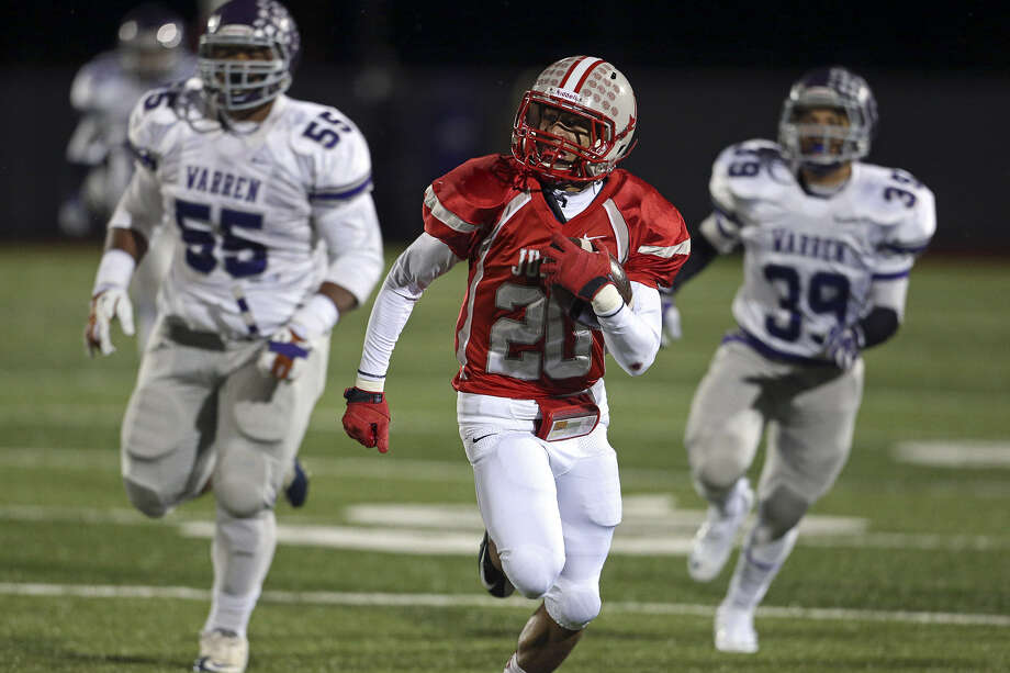 Rocket running back Brandon Sanders breaks away from Warren's Trey Lealaimatafao, left, and Edward Andrew  in the first half of Judson's 50-15 win Friday. Photo: Tom Reel / San Antonio Express-News