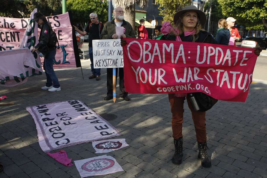 Code pink protestors rally at Octavia park during President Barack Obama's luncheon fundraiser at the SF Jazz Center in San Francisco, Calif., before they get ready to march on Monday, November 25, 2013.  Protesters say that Obama's drone policy is responsible for the deaths of hundreds of innocent civilians in Pakistan and Yemen. Photo: Chronicle