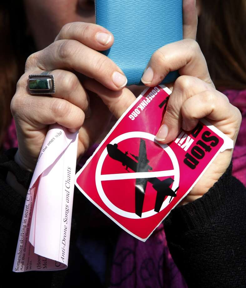 Code pink protestors rally at Octavia park during President Barack Obama's luncheon fundraiser at the SF Jazz Center in San Francisco, Calif., on Monday, November 25, 2013.  Protesters say that Obama's drone policy is responsible for the deaths of hundreds of innocent civilians in Pakistan and Yemen. Photo: Chronicle