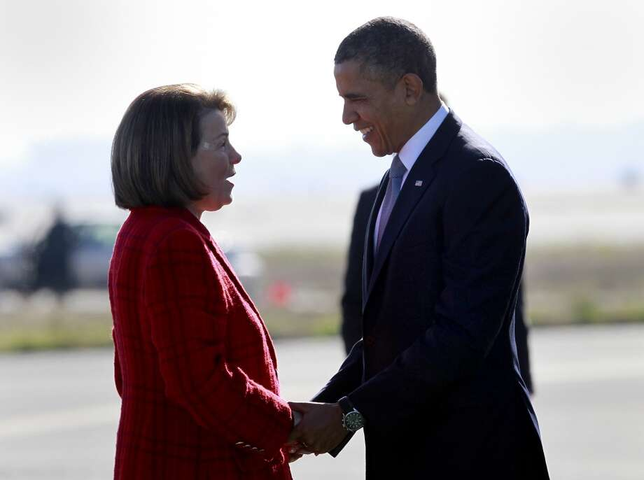 President Obama greeted California Senator Dianne Feinstein after Air Force One landed at SFO Monday November 25, 2013 in San Francisco, Calif. Photo: The Chronicle