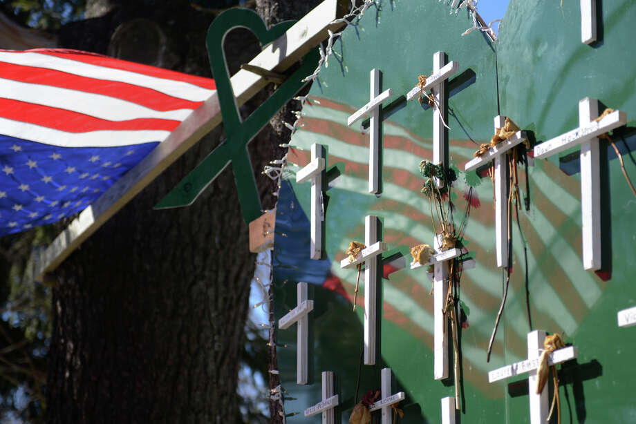 A memorial at a house near Sandy Hook Elementary School in Sandy Hook, Conn. on Thursday, Feb. 21, 2013 commemorates the lives of the 20 students and six staff members were killed at the school on Dec. 14. Photo: Tyler Sizemore / The News-Times
