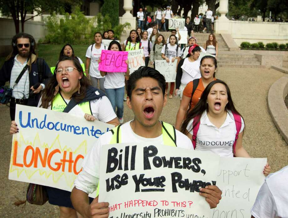 "University of Texas student Jonathan Hernandez, center, 21, marches in an immigration rights rally on the University of Texas campus in Austin, Texas, Wednesday Nov. 20, 2013.  The rally was organized in reaction to the student group Young Conservatives of Texas ""Catch an Illegal Immigrant Game""  that was canceled due to public outrage.  (AP Photo/Austin American-Statesman, Jay Janner) AUSTIN CHRONICLE OUT, COMMUNITY IMPACT OUT, MAGS OUT;  INTERNET AND TV MUST CREDIT PHOTOGRAPHER AND STATESMAN.COM Photo: Jay Janner, MBO / Austin American-Statesman"
