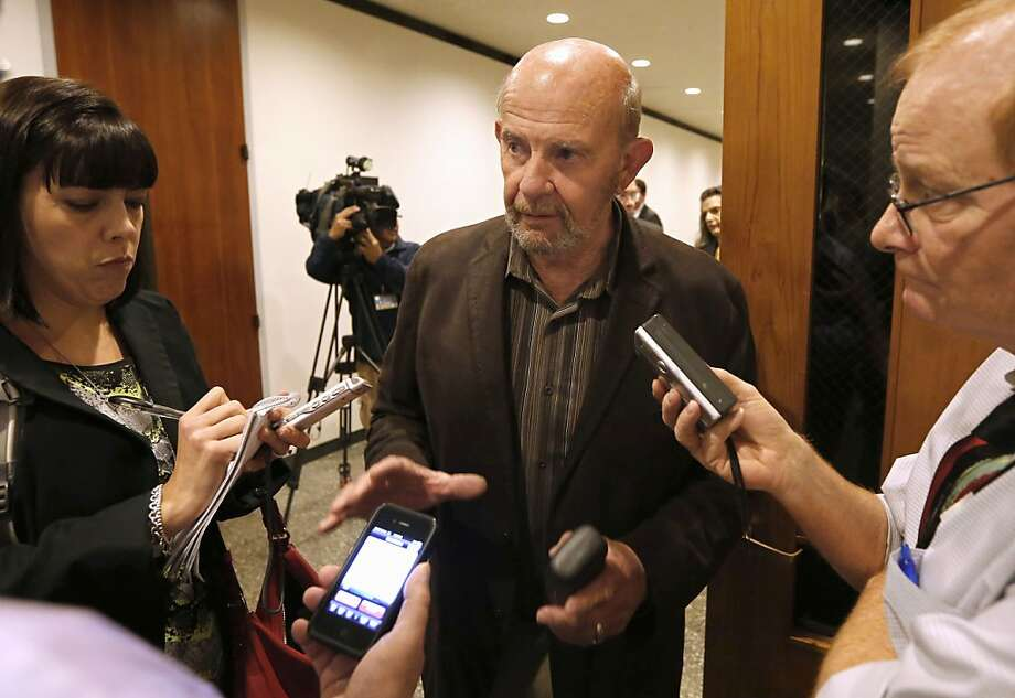 Kings County farmer John Tos, lead plaintiff in a lawsuit against the high-speed rail plan, talks to reporters after a hearing this month. Superior Court Judge Michael Kenny has ruled in favor of the plaintiffs. Photo: Rich Pedroncelli, Associated Press