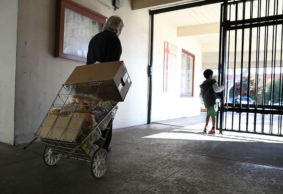 A woman wheels away goods from the Richmond food bank. Photo: Justin Sullivan, Getty Images