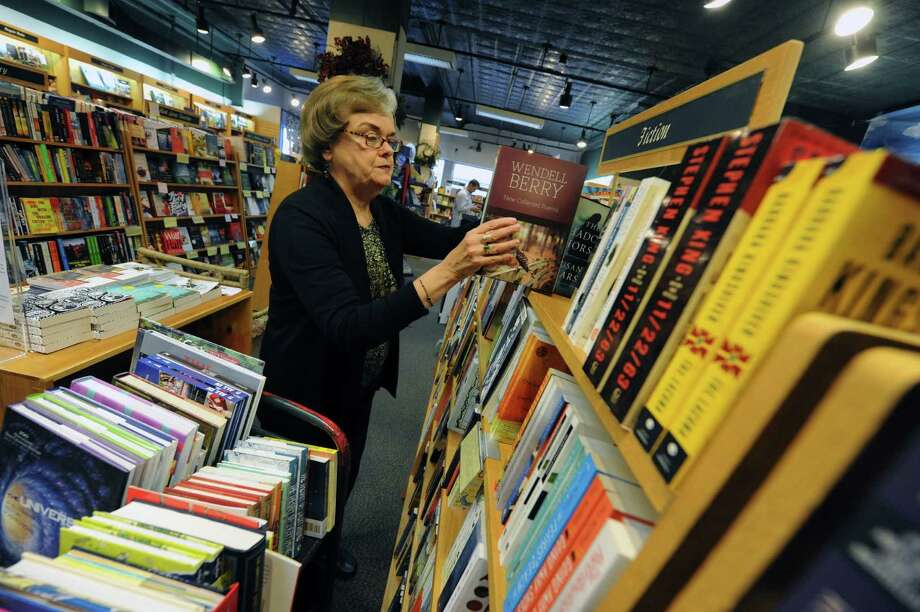 The Open Door Bookstore owner Janet Hutchison, who is retiring after 30 years and selling the business on Jay Street in Schenectady, NY Thursday Oct. 11, 2012. (Michael P. Farrell/Times Union) Photo: Michael P. Farrell / 00019639A