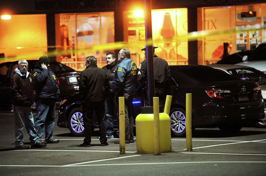State police investigate a double shooting by a Bridgeport police officer in the parking lot of Bayview Plaza on Boston Avenue in Bridgeport, Conn. on Monday, November 25, 2013. Photo: Brian A. Pounds / Connecticut Post