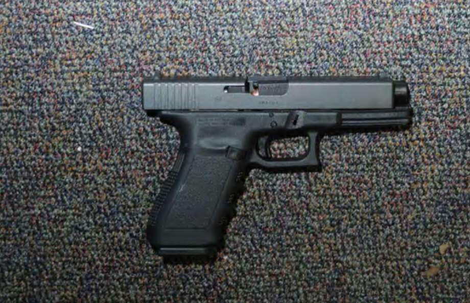 0194- Glock 20, 10mm found near shooter - Rm 10  Photos from the Report of the State's Attorney for the Judicial District of Danbury on the Shootings at Sandy Hook Elementary School and 36 Yoganda Street, Newtown Connecticut. Photo: Office Of The State's Attorney J / Connecticut Post contributed
