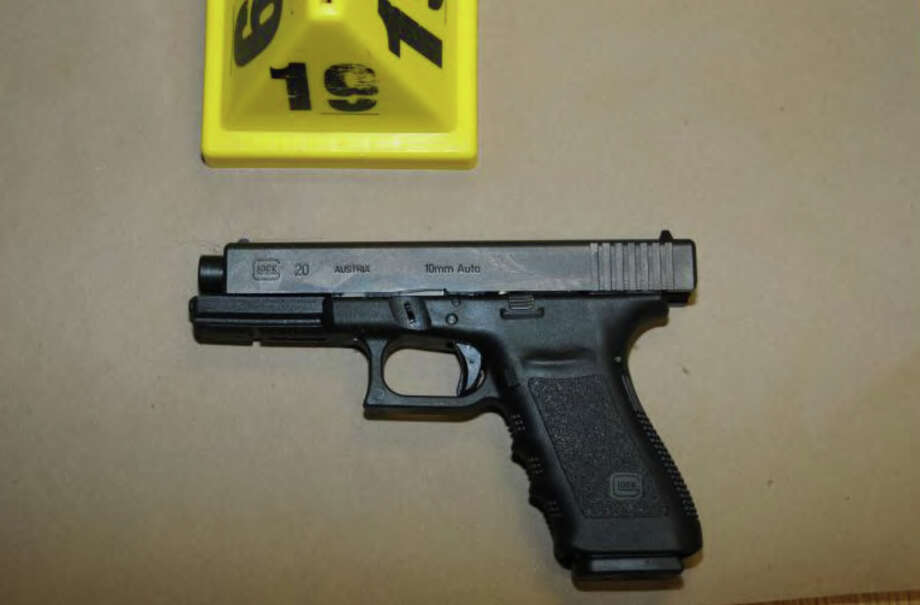 0375- Glock 20, 10mm found near shooter - Rm 10  Photos from the Report of the State's Attorney for the Judicial District of Danbury on the Shootings at Sandy Hook Elementary School and 36 Yoganda Street, Newtown Connecticut. Photo: Office Of The State's Attorney J / Connecticut Post contributed