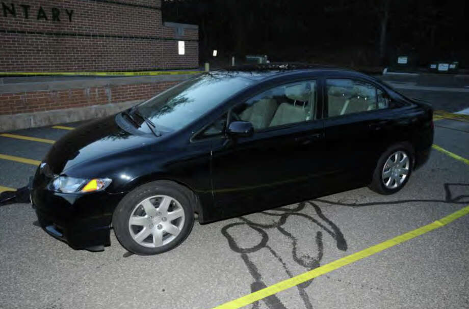016- Shooter's car - Outside SHES - Honda CT Reg. 872YEO  Photos from the Report of the State's Attorney for the Judicial District of Danbury on the Shootings at Sandy Hook Elementary School and 36 Yoganda Street, Newtown Connecticut. Photo: Office Of The State's Attorney J / Connecticut Post contributed