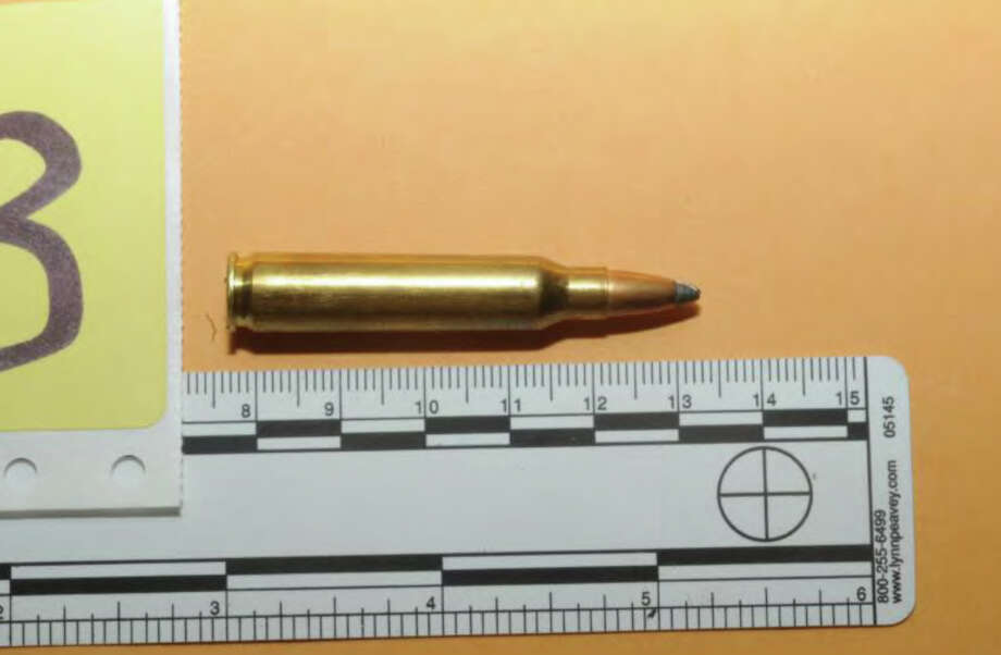 035- 5.56mm from outside shooter's car #503  Photos from the Report of the State's Attorney for the Judicial District of Danbury on the Shootings at Sandy Hook Elementary School and 36 Yoganda Street, Newtown Connecticut. Photo: Office Of The State's Attorney J / Connecticut Post contributed
