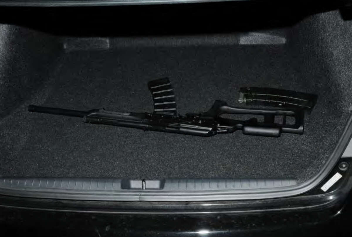 038- Shotgun in trunk of shooter's car Photos from the Report of the State's Attorney for the Judicial District of Danbury on the Shootings at Sandy Hook Elementary School and 36 Yoganda Street, Newtown Connecticut.
