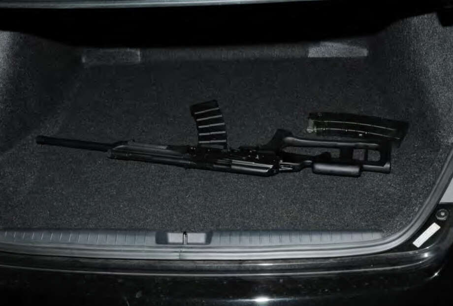 038- Shotgun in trunk of shooter's car  Photos from the Report of the State's Attorney for the Judicial District of Danbury on the Shootings at Sandy Hook Elementary School and 36 Yoganda Street, Newtown Connecticut. Photo: Office Of The State's Attorney J / Connecticut Post contributed