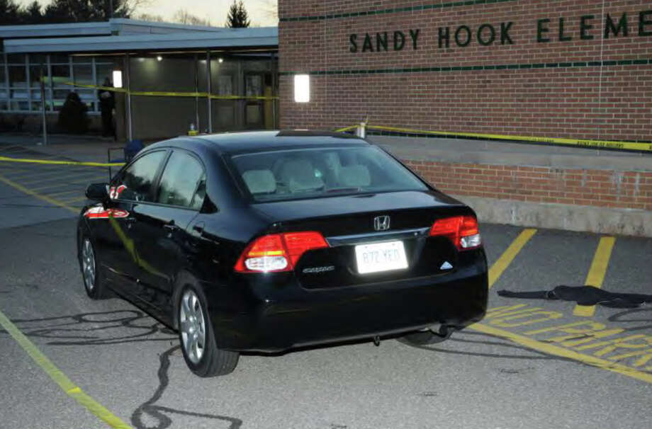 017- Shooter's car - Outside SHES - Honda CT Reg. 872YEO  Photos from the Report of the State's Attorney for the Judicial District of Danbury on the Shootings at Sandy Hook Elementary School and 36 Yoganda Street, Newtown Connecticut. Photo: Office Of The State's Attorney J / Connecticut Post contributed