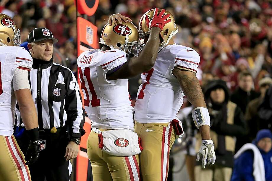 Wide receiver Anquan Boldin #81 and quarterback Colin Kaepernick #7 of the San Francisco 49ers celebrate after Boldin catches a 19-yard touchdown in the first quarter against Washington at FedExField on November 25, 2013 in Landover, Maryland. Photo: Rob Carr, Getty Images