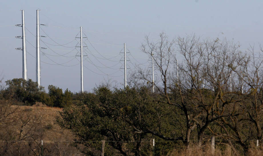 Giant electric transmission lines tower over the landscape near Menard. Texas manufacturers have come out against the state adopting what is called a capacity market. Photo: John Davenport / San Antonio Express-News