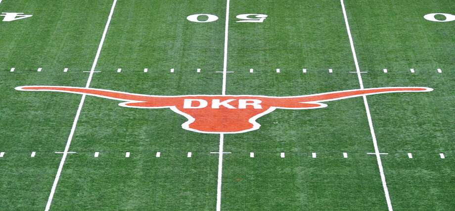 The initials of former Texas football coach Darrell K. Royal were painted inside the longhorn logo on the field at Darrell K. Royal-Memorial Stadium, Saturday, Nov. 10, 2012, in Austin, Texas. The initials were added in honor of Royal who passed away on Wednesday. (AP Photo/Michael Thomas) Photo: Michael Thomas, Associated Press / FR65778 AP